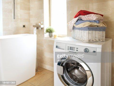 White Washing Machine In The Bathroom Stock Photo Getty