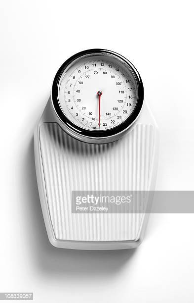 White weighing scales with copy space