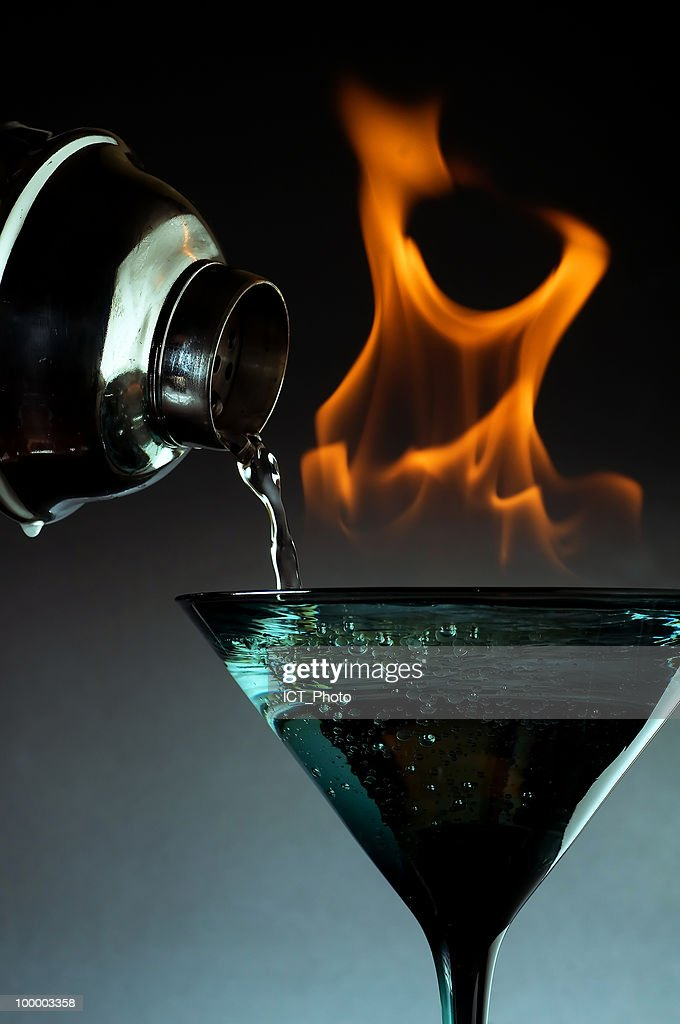 White Wine Pouring into a Glass with Fire : Stock-Foto