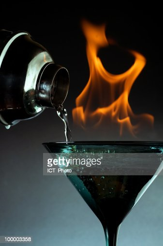 White Wine Pouring into a Glass with Fire : Stock Photo