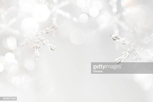 A white winter background with ice snowflakes