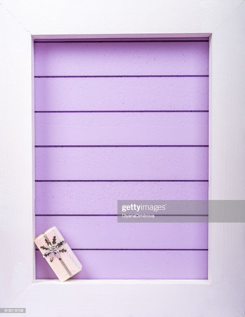 White wooden frame and  christmas decoration over a purple background : ストックフォト