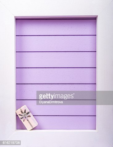 White wooden frame and  christmas decoration over a purple background : Stockfoto