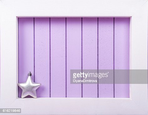 White wooden frame and  christmas decoration over a purple background : Foto stock