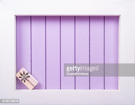 White wooden frame and  christmas decoration over a purple background : Bildbanksbilder