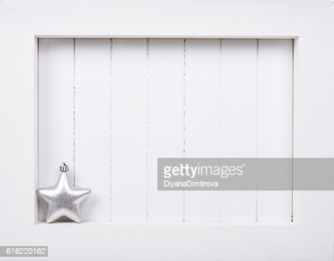 White wooden frame and  christmas decoration over white background : Stockfoto