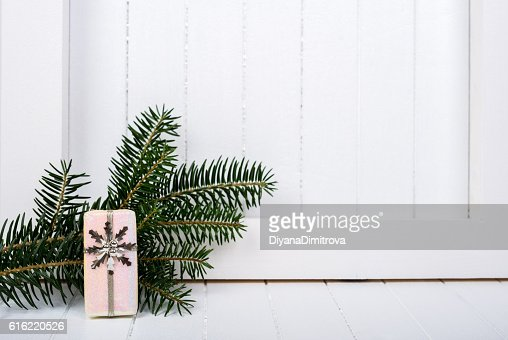 White wooden frame and  christmas decoration over white background : Foto stock
