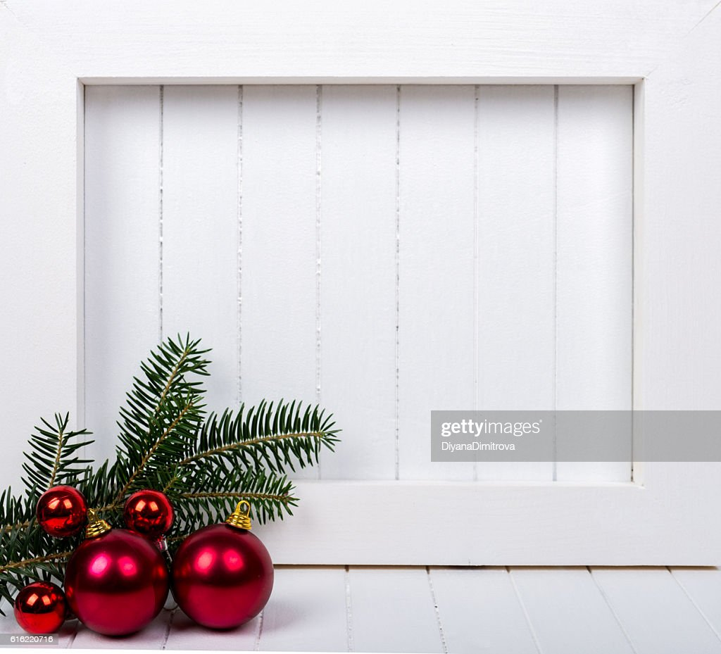 White wooden frame and  christmas decoration over white background : Stock Photo