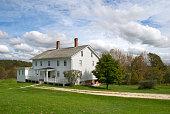 White wooden New England farmhouse