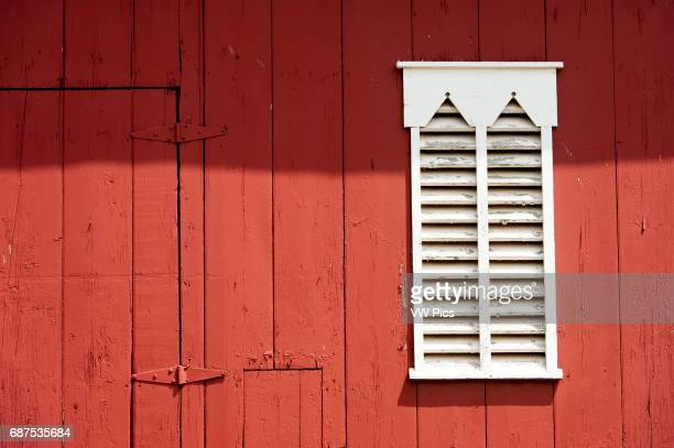 White wooden shutters on red barn in Westminster Maryland USA