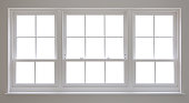 a set of beautifully crafted white wooden windows with an isolated white background. A clipping path has been provided to enable you to place a background image of your choice. For best results, click