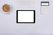 White workspace and blank screen tablet