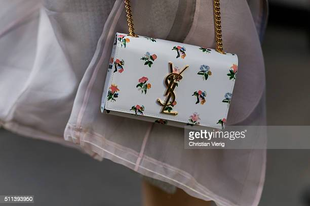 A white Yves Saint Laurent bag seen outside Eudon Choi during London Fashion Week AW16 on February 19 2016 in London England United Kingdom