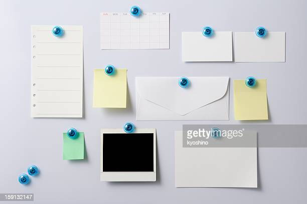 Whiteboard with attached items,Blank Polaroid,Envelope,Adhesive Note,Note Pad