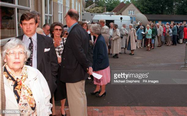 Whitehaired activists from the heartland of Conservative Surrey were queuing by the hundred at Reigate grammar school tonight as their MP Sir George...