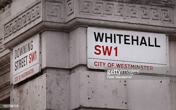 Whitehall and Downing Street signs are displayed on a corner of a government building on July 8 2010 in London England Whitehall is an area of...