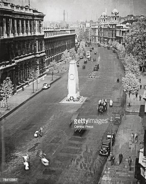 Whitehall in London's Westminster with the Cenotaph in the centre of the road circa 1935