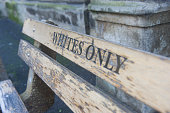 Whites only sign on a bench