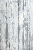 SUnbleached old barn wood with cracked and pealing white paint.