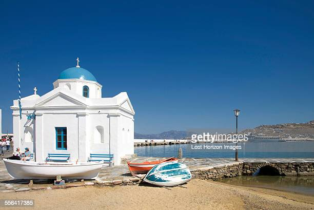 Whitewashed church in harbor, Mykonos, Cyclades, Greece