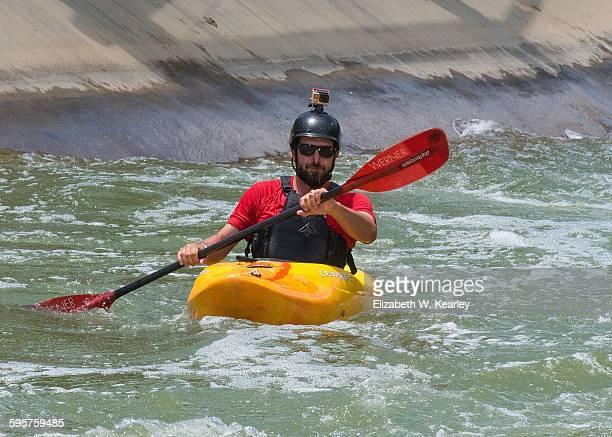 Whitewater kayak rider wearing camera on helmet