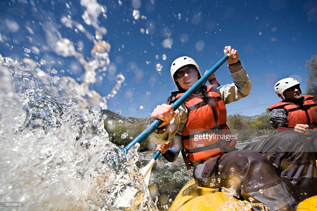 Whitewater Rafters Splashing Water