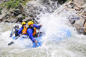 A group of friends whitewater raft on Clear Creek in Colorado
