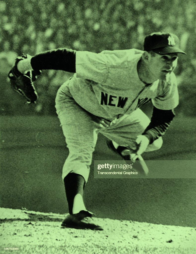 Whitey Ford of the New York Yankees is pitching in a World Series game against the Reds in October of 1961 in Cincinnati, Ohio.
