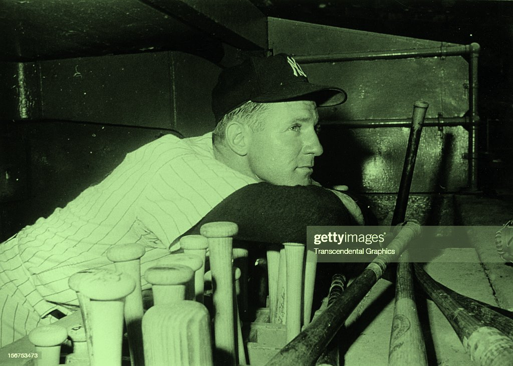 Whitey Ford of the New York Yankees poses reflectively in the dugout circa 1960 In Yankee Stadium in New York City.