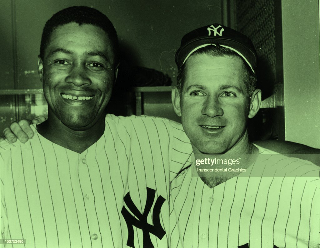 Whitey Ford, right, and Elston Howard of the New York Yankees pose for a clubhouse photo circa 1965 In Yankee Stadium in New York City.