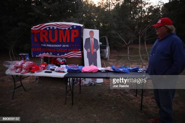 Whitey Taylor sells President Donald Trump items as people arrive to hear Republican Senatorial candidate Roy Moore speak during a campaign event at...