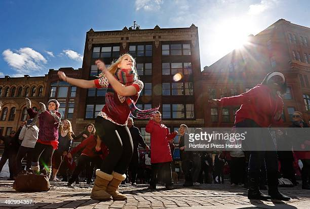 Whitley Newman of Portland leads people in a flashmob dance to the song 'Break the Chain' in Monument Sqaure Thursday February 14 to kick off a...