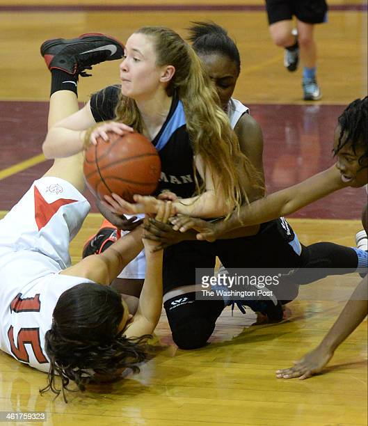 Whitman guard Marissa Cannon breaks out of the pile to pass off the loose ball during second half action against Blair on January 10 2014 in Silver...
