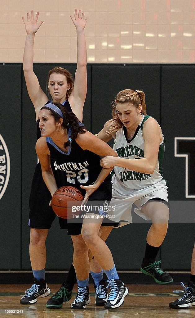 Whitman's Dani Okon, left, steals the ball away from Walter Johnson's Kristen Larrick under the Walter Johnson basket during the game at Walter Johnson High School on Friday, December 21, 2012. Whitman defeated Walter Johnson 44-42.