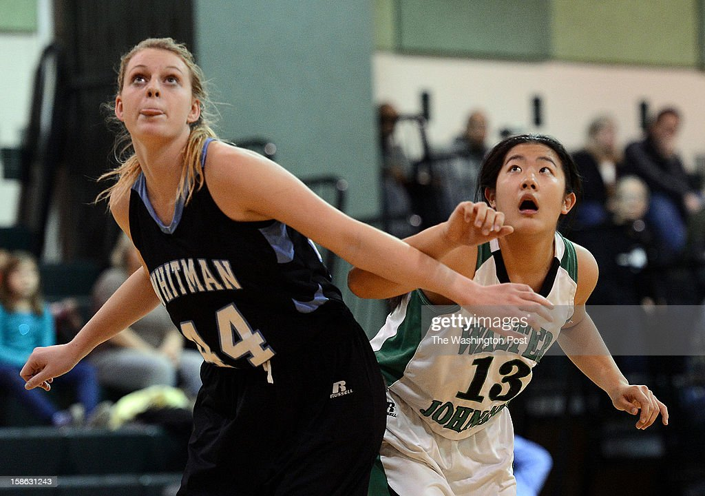 Whitman's Linn Bumpers, left, and Walter Johnson's Samantha Lee, right, wait for the rebound from a free throw during the game at Walter Johnson High School on Friday, December 21, 2012. Whitman defeated Walter Johnson 44-42.