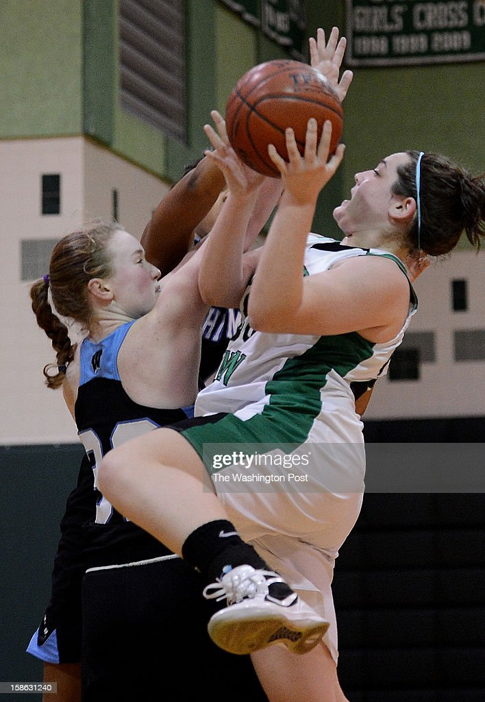 Whitman's Marie Hatch, left, tries to stop Walter Johnson's Melanie Ackerman, right, as she goes up for a shot during the game at Walter Johnson High School on Friday, December 21, 2012. Whitman defeated Walter Johnson 44-42.