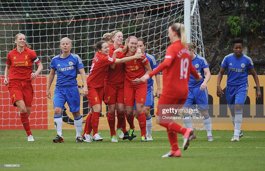 <a gi-track='captionPersonalityLinkClicked' href=/galleries/search?phrase=Whitney+Engen&family=editorial&specificpeople=7489472 ng-click='$event.stopPropagation()'>Whitney Engen</a> of Liverpool is congratulated after scoring their first goal during the FA WSL match batween Chelsea Ladies FC and Liverpool Ladies FC at Wheatsheaf Park on May 12, 2013 in Staines, England.
