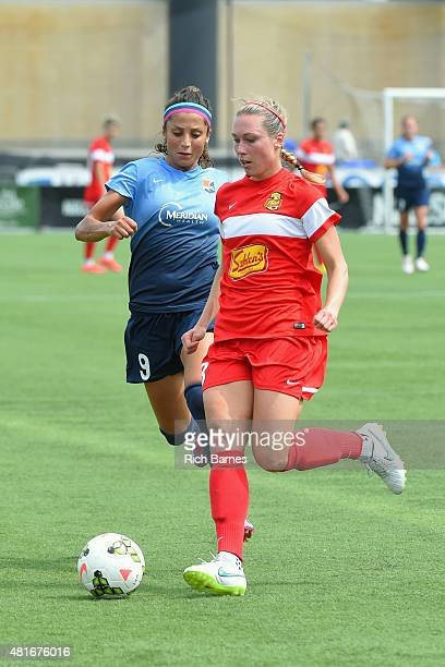 Whitney Engen of the Western New York Flash controls the ball against the defense of Nadia Nadim of the Sky Blue FC during the first half at Sahlen's...