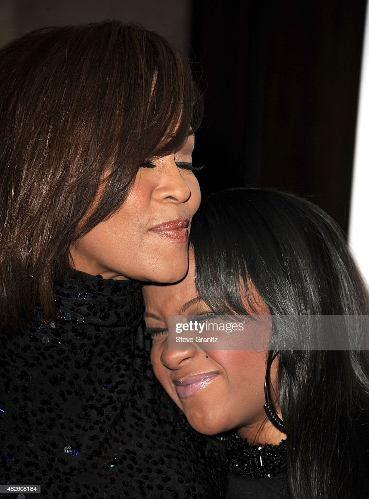 Whitney Houston and Bobbi Kristinaarrives Clive Davis And The Recording Academy's 2011 Pre-GRAMMY Gala at The Beverly Hilton hotel on February 12, 2011 in Beverly Hills, California.