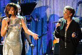 Whitney Houston and Dionne Warwick perform onstage at the 2011 PreGRAMMY Gala and Salute To Industry Icons Honoring David Geffen at Beverly Hilton on...