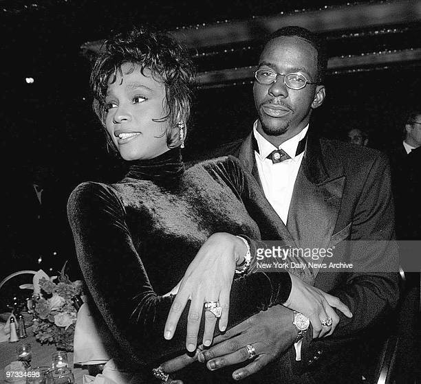 Whitney Houston and husband Bobby Brown at a TJ Martell benefit dinner at the Hilton
