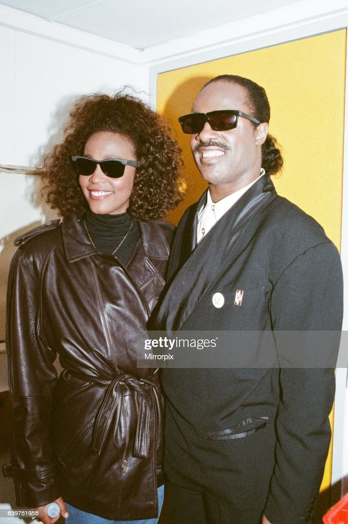 Whitney Houston and Stevie Wonder smile for a photograph backstage at the Nelson Mandela concert in London on 11th June 1988.