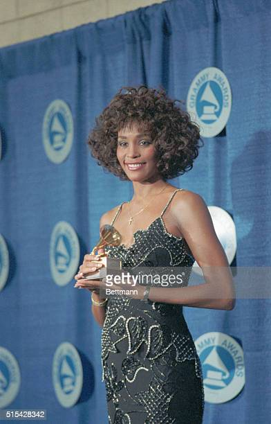 Whitney Houston is overjoyed at winning the Grammy Award for Best Pop Vocal Performance for her song 'I Wanna Dance With Somebody ' which she...