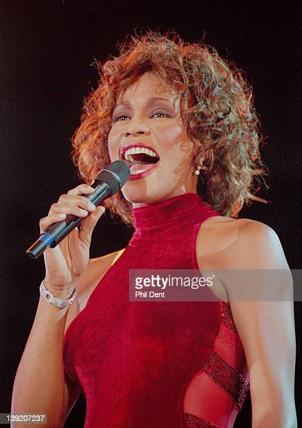 Whitney Houston performs on stage in 1996