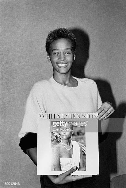 Whitney Houston photographed holding a copy of her first album at the at the Arista Records Studio in New York on September 6 1984