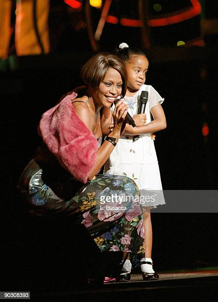 Whitney Houston with her daughter Bobbi Kristina Brown onstage during a concert on July 16 1999 in New York City