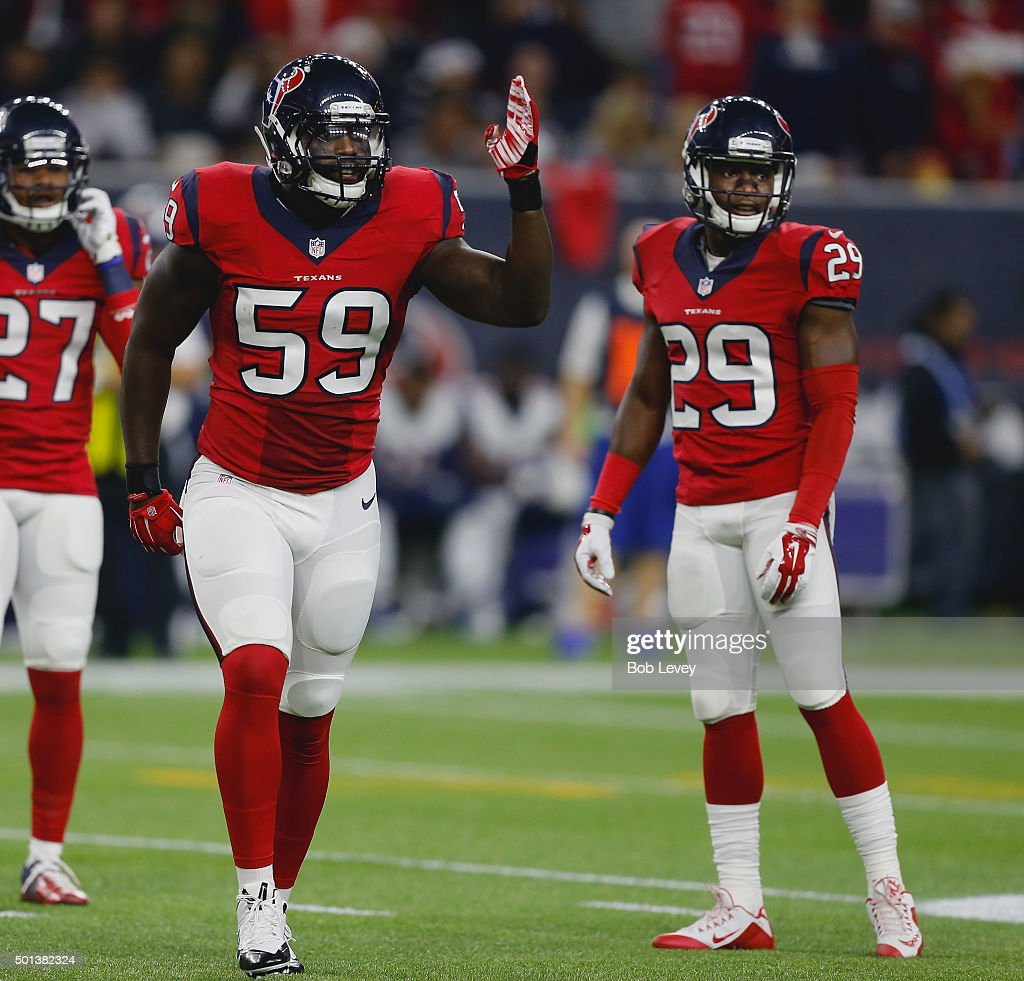 Whitney Mercilus #59 of the Houston Texans and Andre Hal #29 look toward the bench at NRG Stadium on December 13, 2015 in Houston, Texas.