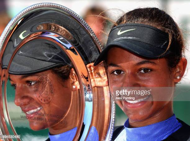 Whitney Osuigwe of The United States celebrates victory with the trophy following the girls singles final match gainst Claire Liu of The United...