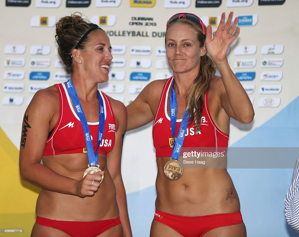 Whitney Pavlik (L) and Jennifer Kessy of USA celebrate during the medals ceremony at the FIVB Durban Open at New Beach on December 14, 2013 in Durban, South Africa.