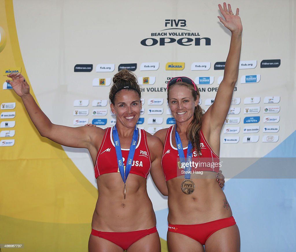 Whitney Pavlik (L) and <a gi-track='captionPersonalityLinkClicked' href=/galleries/search?phrase=Jennifer+Kessy&family=editorial&specificpeople=2190049 ng-click='$event.stopPropagation()'>Jennifer Kessy</a> of USA celebrate during the medals ceremony at the FIVB Durban Open at New Beach on December 14, 2013 in Durban, South Africa.